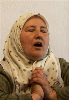 Bosnian Muslim Fadila Efendic, 56, of Srebrenica, reacts during a live TV broadcast from the World Court decision in The Hague, at her the home in the village of Potocari near Srebrenica, Bosnia 120 kilometers (75 miles) northeast of Sarajevo, Monday, Feb. 26, 2007.