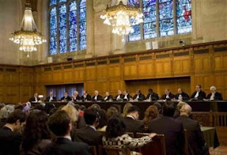 Overview of the courtroom of the the International Court of Justice in the Hague February 26, 2007, as the International Court of Justice President Judge Rosalyn Higgins (7th R) reads the verdict.