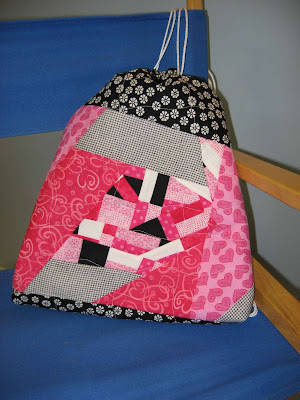 Pink and black crazy quilted cinch sack