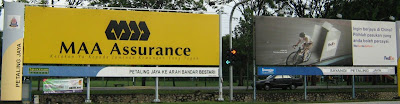 landmark T-junction billboards turn right to Damansara Jaya Uptown