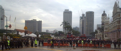 Al Jazeera TV crew in front of riot squad barricade blocking Dataran Merdeka