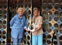 Sisters holding one of the special tiles for the entryway