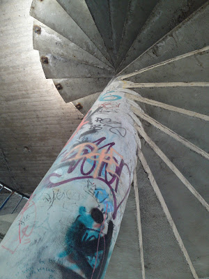 spiral staircase, graffiti,