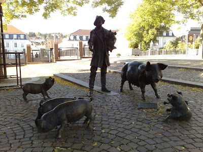 pigs, statues, swineherd