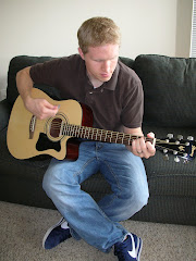 Todd jamming out on his guitar