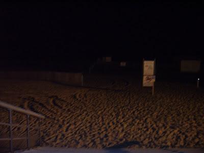 The night at Jones Beach with tire tracks.