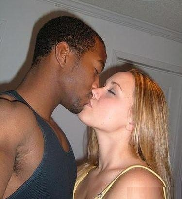 white wife kissing black guy at a nightclub