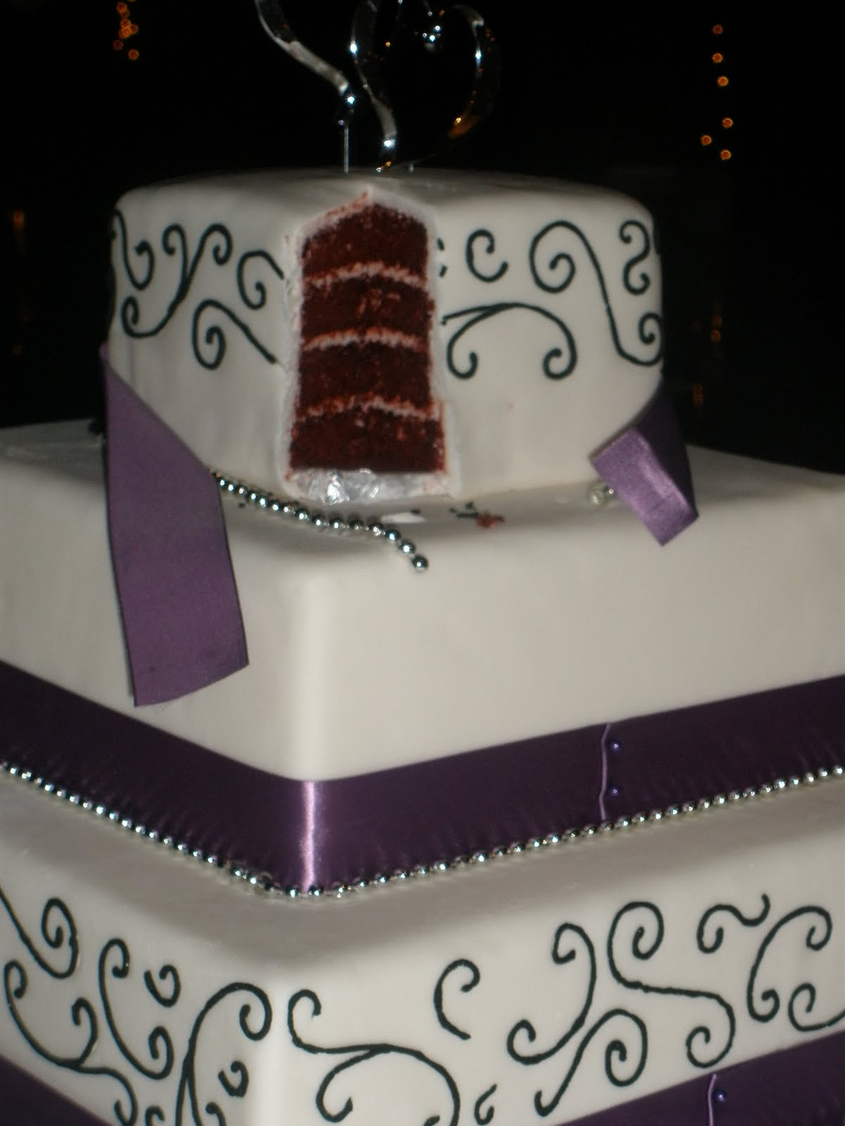 It\'s a piece of cake: Purple and black scroll square cake