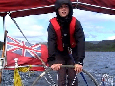 ... the Firth of Clyde from their boat. [Pictured: Morgan Brown at the helm.