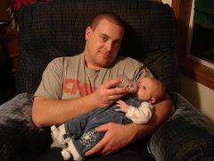 Daddy feeding Maddie