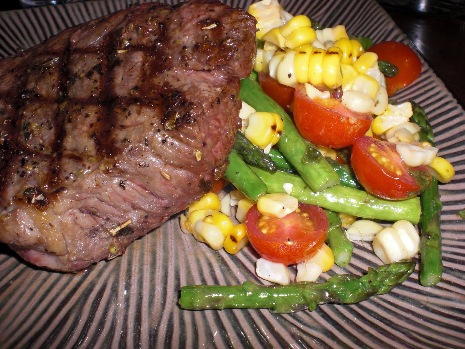 Grilled Sirloin Steaks With Corn, Asparagus, And Tomato Salad