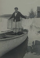 Liz hanging clothes during the 1950 flood
