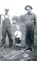 From left to right is William S. Ash, William H. Ash and William Ash all of rural St. Vincent, MN. Photo taken in 1933