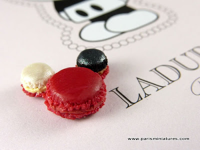 Miniature Mickey Macaroon by Emmaflam and Miniman shown on the full sized Ladurée box