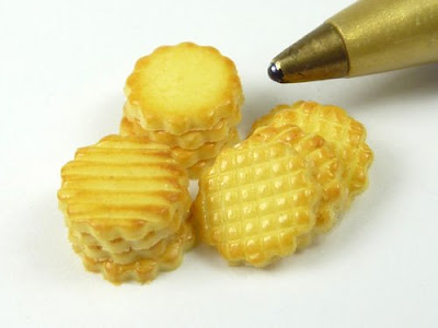 Tiny miniature butter cookies shown with a pen nib