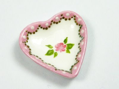 Handpainted heartshaped dish with rose motif and pretty pink border