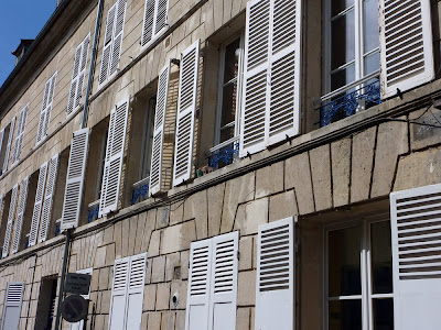 Open and closed shutters on a building at Compiègne
