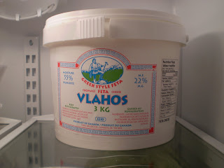 A tub of Vlahos Greek Style Feta made by Tiras Dairies of Camrose, Alberta