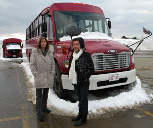 Isabelle Hains and Ana Acevedo in front of the new multifunctional buses at Bathurst High School, March 7, 2009