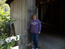 Me again posing in front of a covered bridge