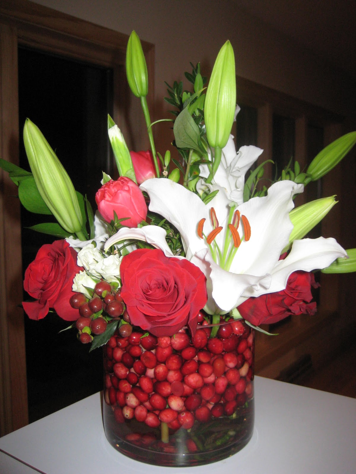Allison phalen floral design november 2010 i used red roses burgundy calla lilies white oriental lilies and other seasonal flowers and greens to complete their designs it was the perfect kick off mightylinksfo