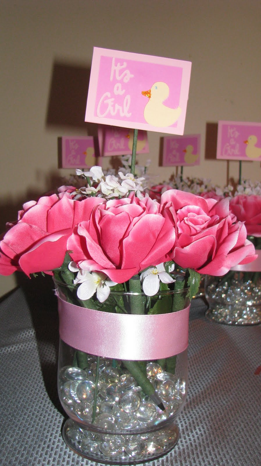 Creatively challenged baby shower centerpieces for Baby shower flower decoration ideas