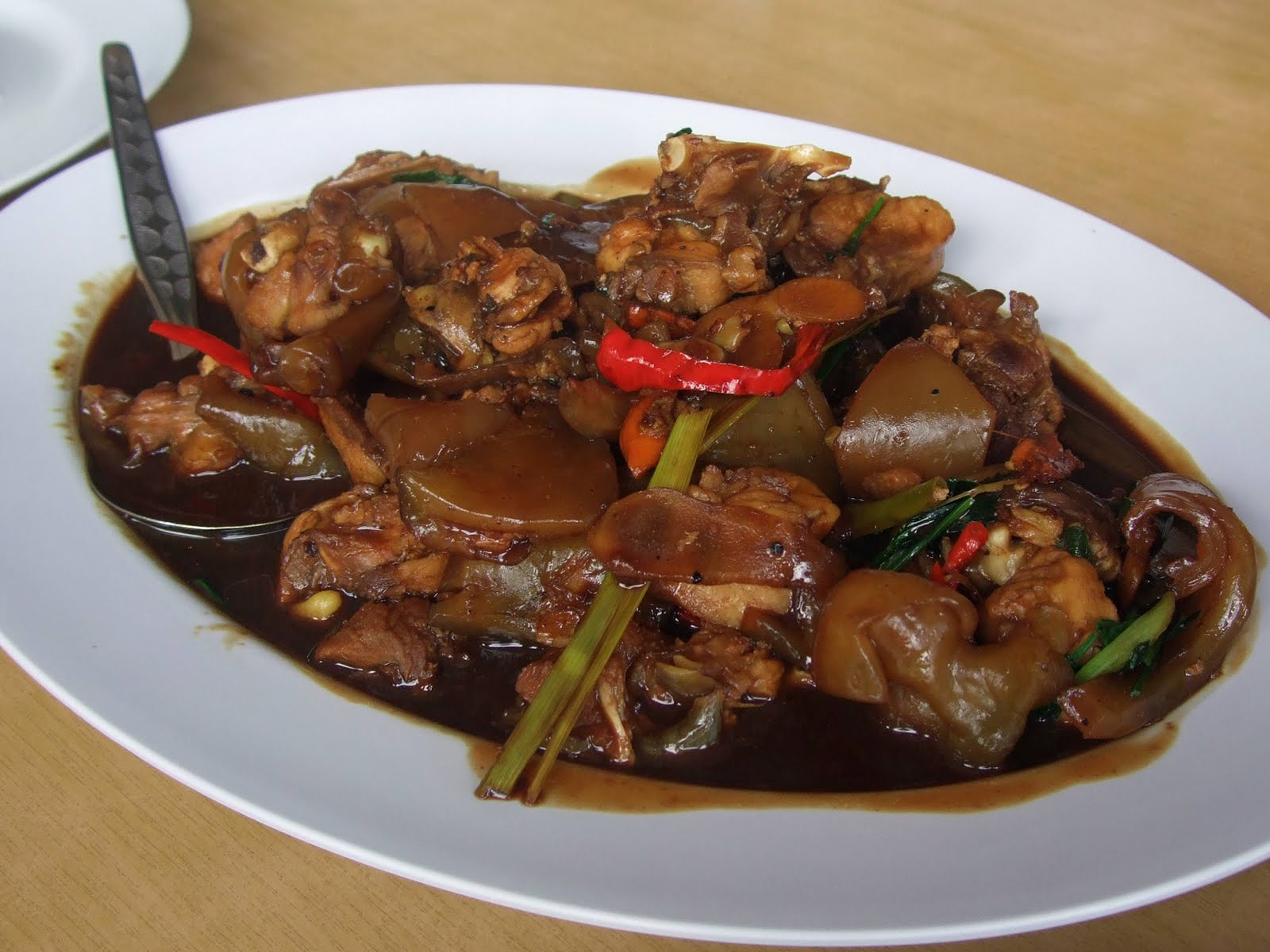 Next came the ubiquitous midin. This was stir-fried with garlic and ...