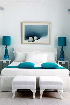 Love the simple bedding here and those teal lamp shades! MMMM!