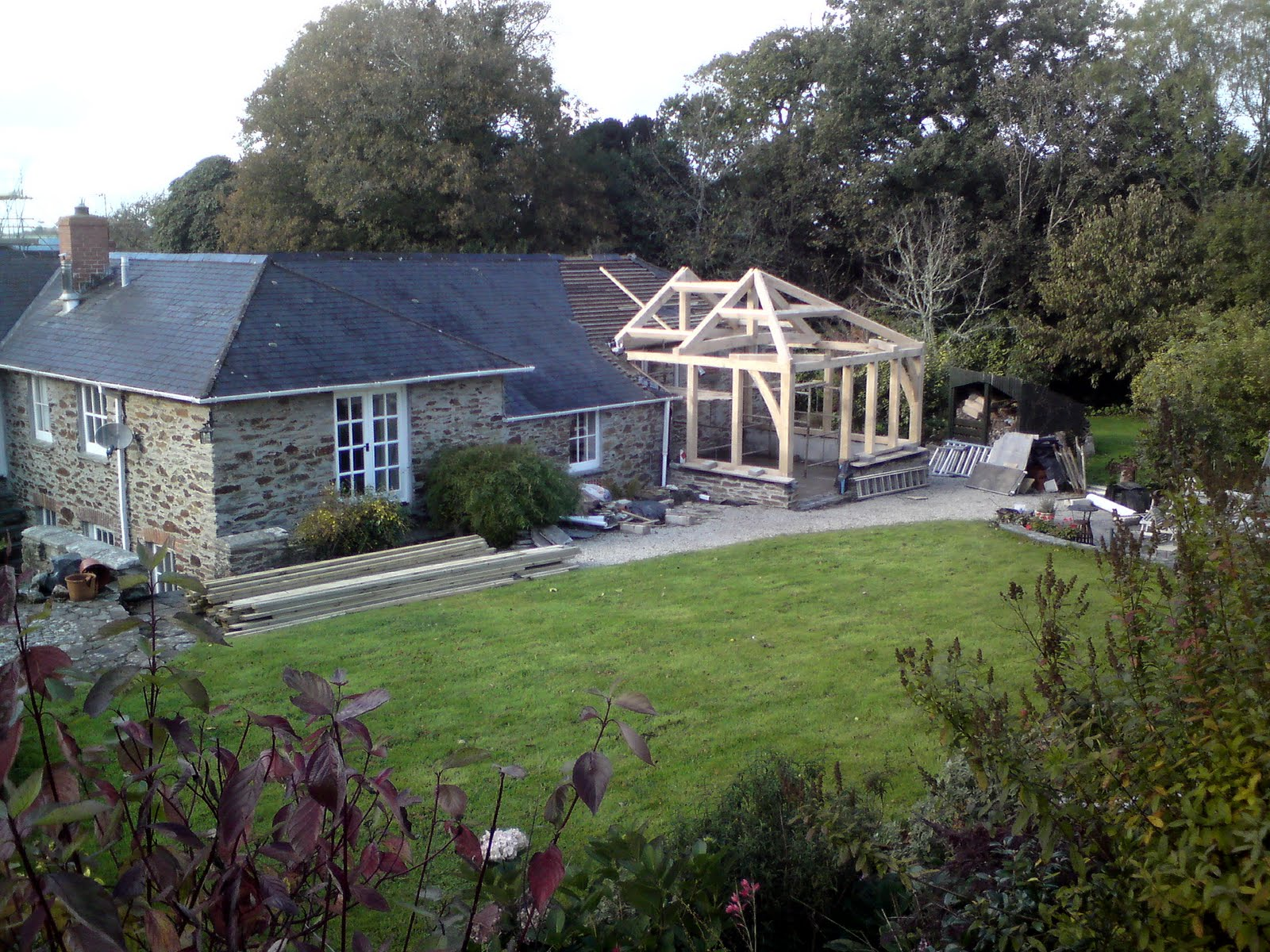 tren or wood works green oak frame extension with hipped roof