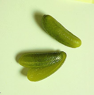 A halved pickled gherkin