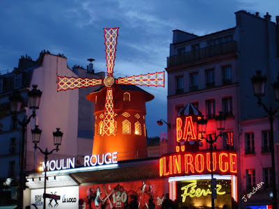 Moulin Rouge by night in Paris