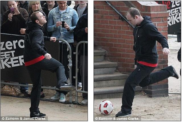Wayne Rooney Street Striker Wayne Rooney doesn t look very injured as he films new series of