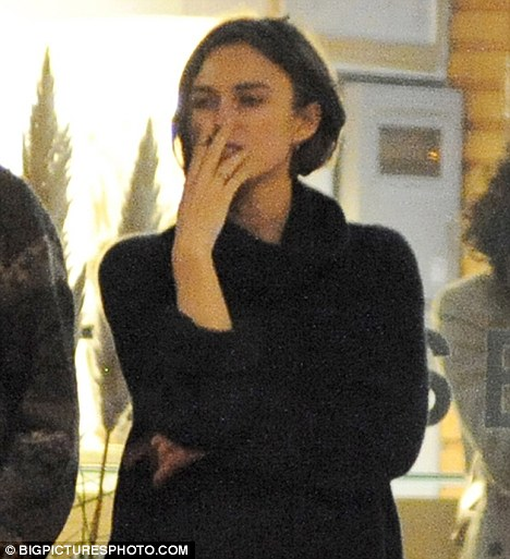 Burning desire: Keira Knightley took time out at a dinner with friends at