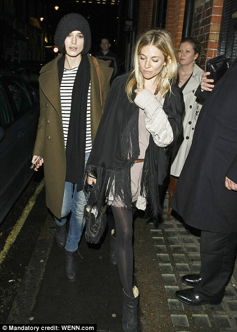 Girls' night out: Sienna Miller takes newly-single Keira Knightley out for