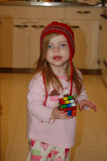No, she hasn't solved the Rubik's cube yet