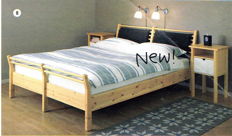 This is the bed we have; a queen sized Sorum bed by Ikea. This is one of  the few photos I could find online of it (from an old catalog):