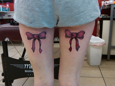 Pink bows tattoo