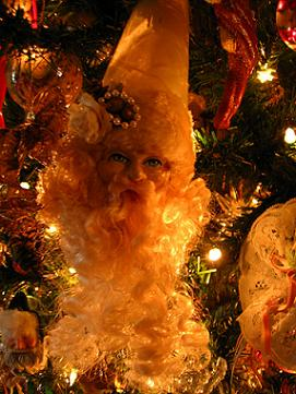Celebrate the Month of Death-cember! Click On the Creepy Golden Santa for All the Holiday Goodies!