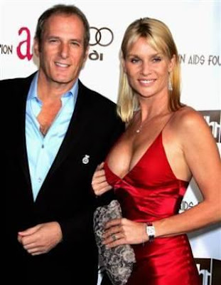 Nicollette Sheridan in cleavage with Michael Bolton