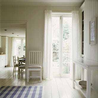 Here you see a classic Swedish style chair. Looking to the kitchen you