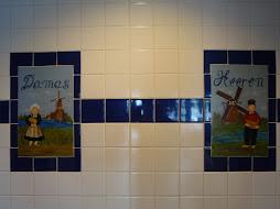 signs in the toilet of a Dutch Pannekoeken restaurant
