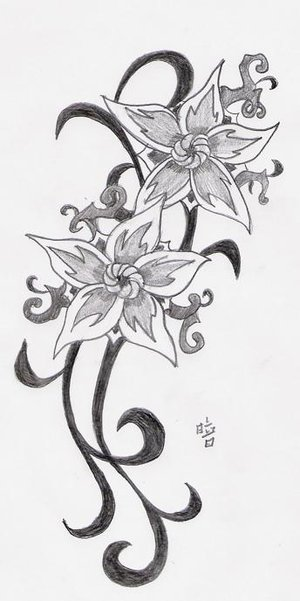 cool tattoo design on leg of small flower tattoo