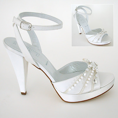 Rhinestone teardrops in wedding shoes high heels .