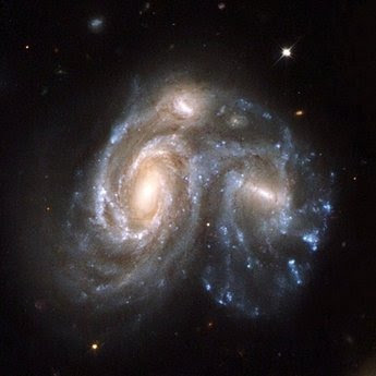 A collision between two spiral galaxies in the constellation of Hercules.
