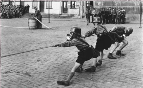 Kids in Gas Masks Playing Tug of War