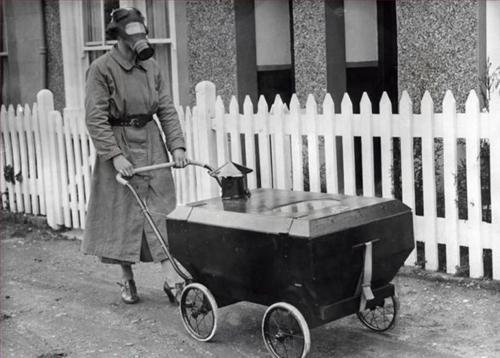 Man Walking with Gas Mask and Strange Stroller Contraption