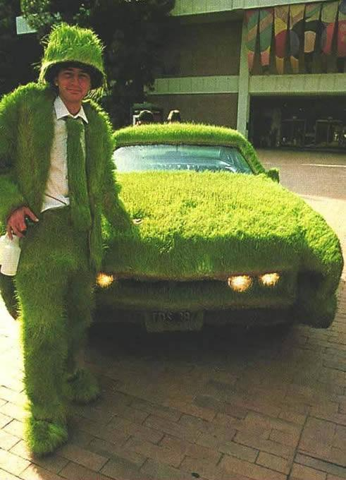 Man in Grass Suit, Car Covered in Grass