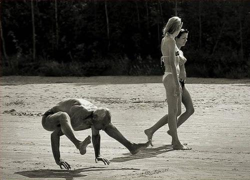 Two Hot Women and a Man Walking On His Hands