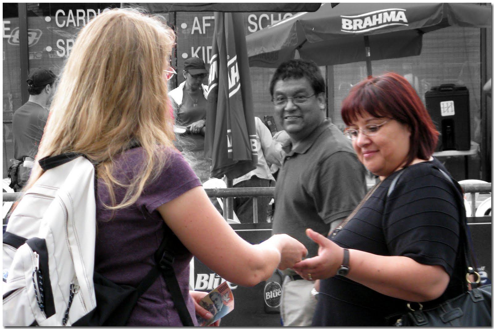 Image of woman handing out Gospel Tract, via The Word Street Jorunal