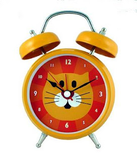 alarm clock with cat face on the clock face